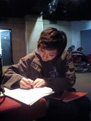 わっさん、字を書く